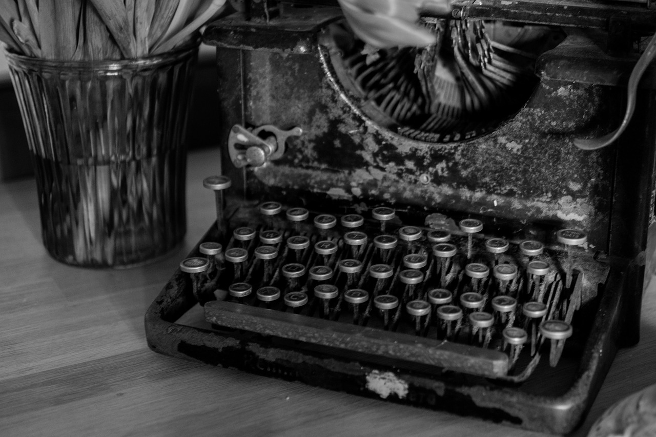 A vintage typewriter sits on a desk; the photo is in black and white. A good argument can be made on typewriters just like this one.