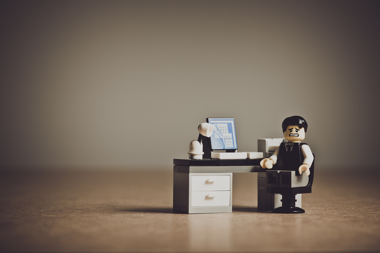 Are you doing the hard work or the right work? It's tough to figure out. Picture features a Lego character sitting at a tiny desk with a computer. The Lego looks a little sad.